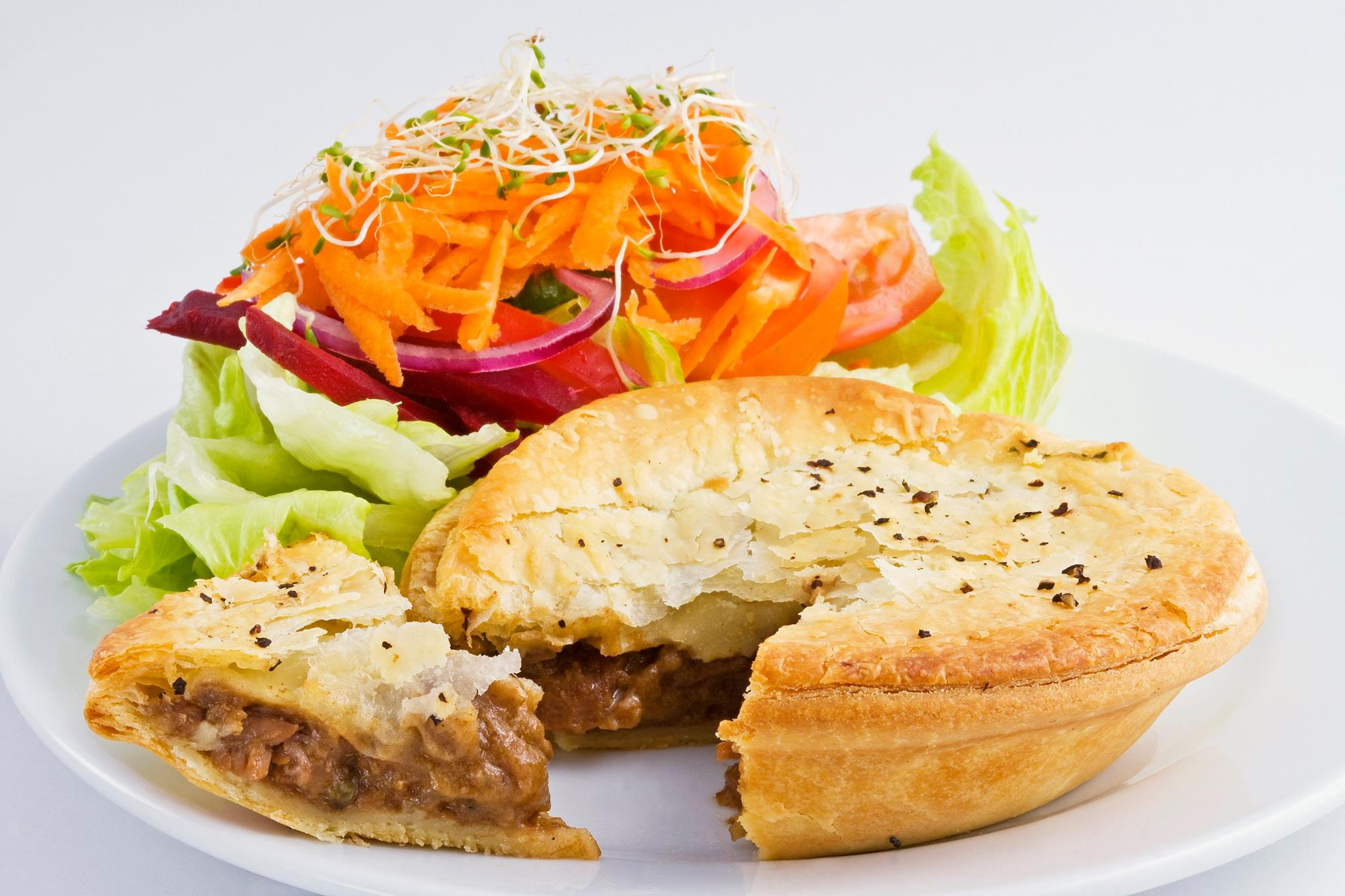Pie and salad at The Courtyard Cafe Mogo