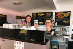 Courtyard Cafe Mogo staff with reusable takeaway coffee cups